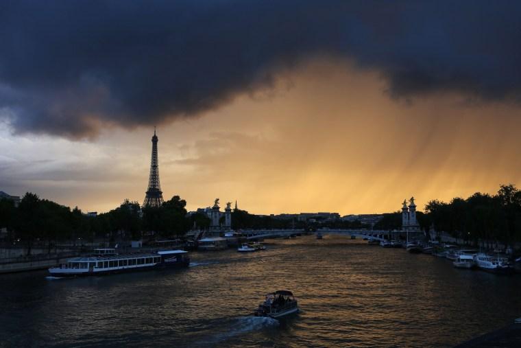 Image: Dark clouds and rain loom over Paris
