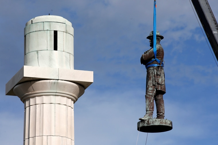 Image: A monument of Robert E. Lee, who was a general in the Confederate Army, is removed in New Orleans