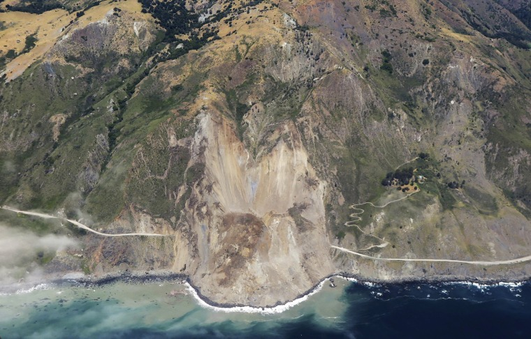 Image: A massive landslide along California's coastal Highway 1 buries the road under a 40-foot layer of rock and dirt