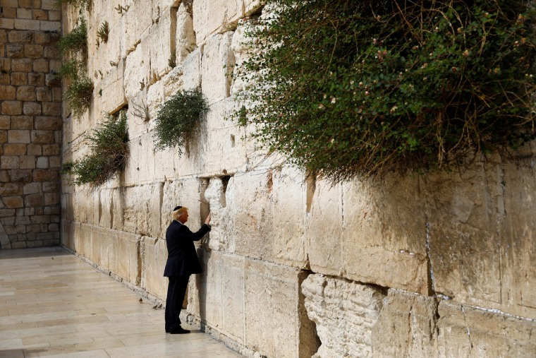 Image: Trump touches the Western Wall, Judaism's holiest prayer site, in Jerusalem's Old City