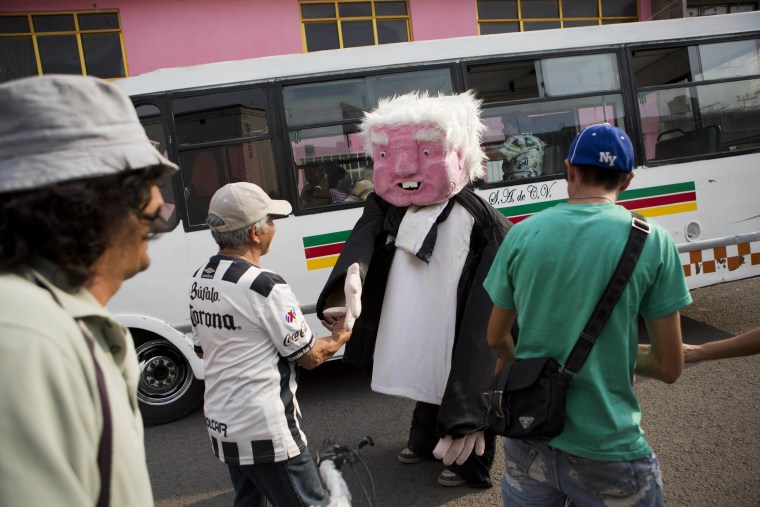 In this May 19, 2017 photo, a performer dressed as presidential hopeful Andres Manuel Lopez Obrador shakes hands with supporters after a campaign rally for Delfina Gomez, who's running for governor of Mexico state with Obrador's party, the National Regeneration Movement, or Morena, in Ecatepec, Mexico state, Mexico.