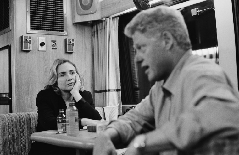 Image: On a campaign bus on their way from Portland to Seattle, American President Bill Clinton speaks with Washington state gubernatorial candidate Gary Locke, while First Lady Hillary Clinton watches, Washington, Sept. 20, 1996.