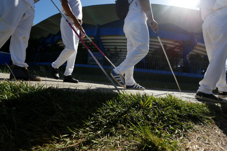 Image: The visually impaired arrive at the Changa Medero stadium for a baseball lesson, in Havana