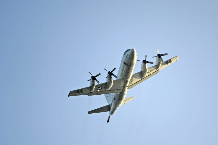 Image:  A U.S. Navy P-3 Orion performs a flyover in Hawaii