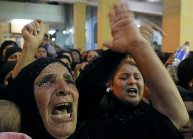 Image: Relatives of victims of an attack that killed at least 28 Coptic Christians on Friday react at the funeral in Minya