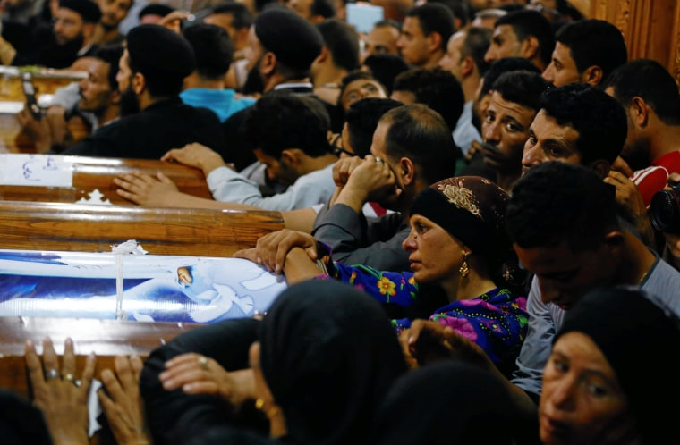 Image: Mourners gather at the Sacred Family Church for the funeral of Coptic Christians who were killed in Minya