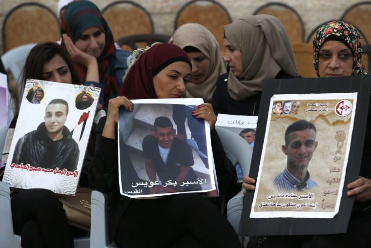 Image: Women hold portraits of relatives imprisoned in Israeli jails during a protest in east Jerusalem.