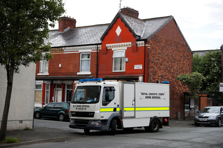 Image: A bomb disposal unit stops outside a street in Moss Side, Manchester