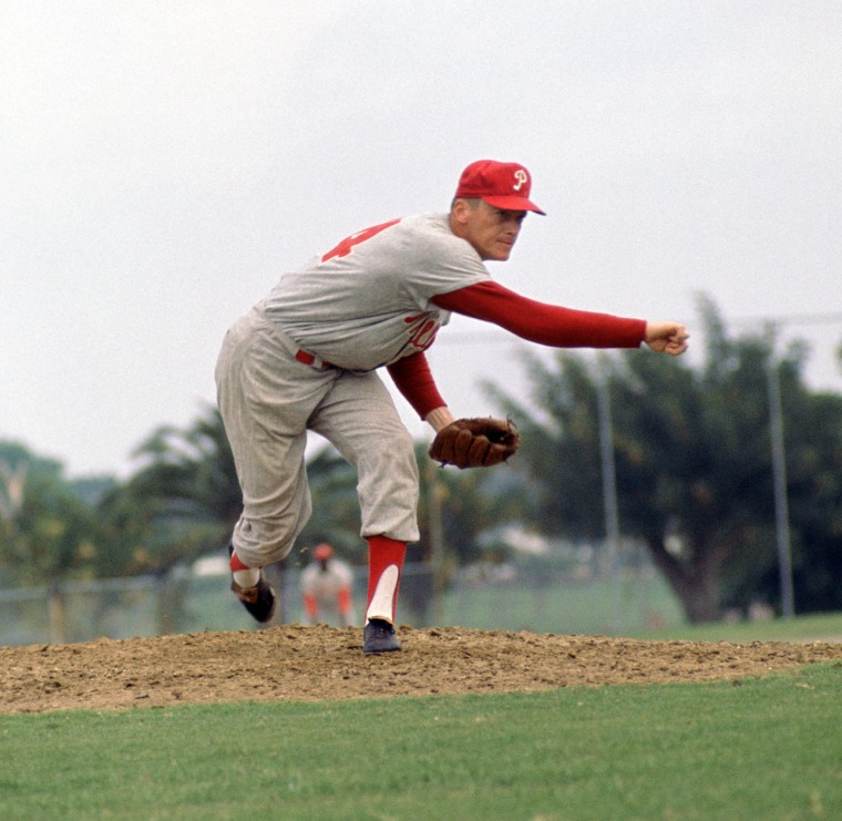 Image: Jim Bunning, number 14 for the Philadelphia Phillies, during a game from his 1964 season. Bunning played for 17 years with 4 different teams. He was 7-time All-Star and was inducted to the Baseball Hall of Fame in 1996.