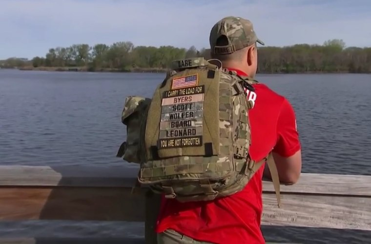 "A veterans support group called ""Carry the Load"" organizes marches nationwide where volunteers carry the names of fallen friends on their fully-loaded backpacks to shine a light on their sacrifices."