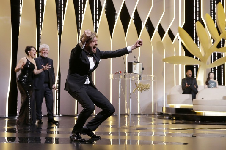 Image: Director Ruben Ostlund, right, celebrates winning the Palme d'Or award for his film The Square, during the awards ceremony at the 70th international film festival, Cannes, southern France, May 28, 2017.