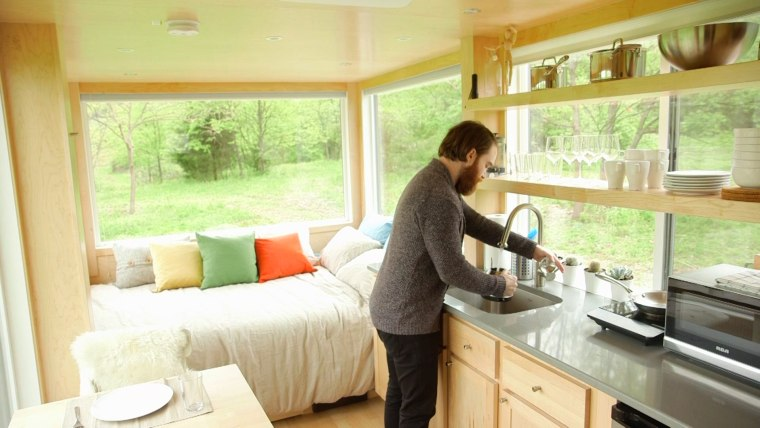 Seth Porges makes breakfast in his tiny home in the Hudson Valley.
