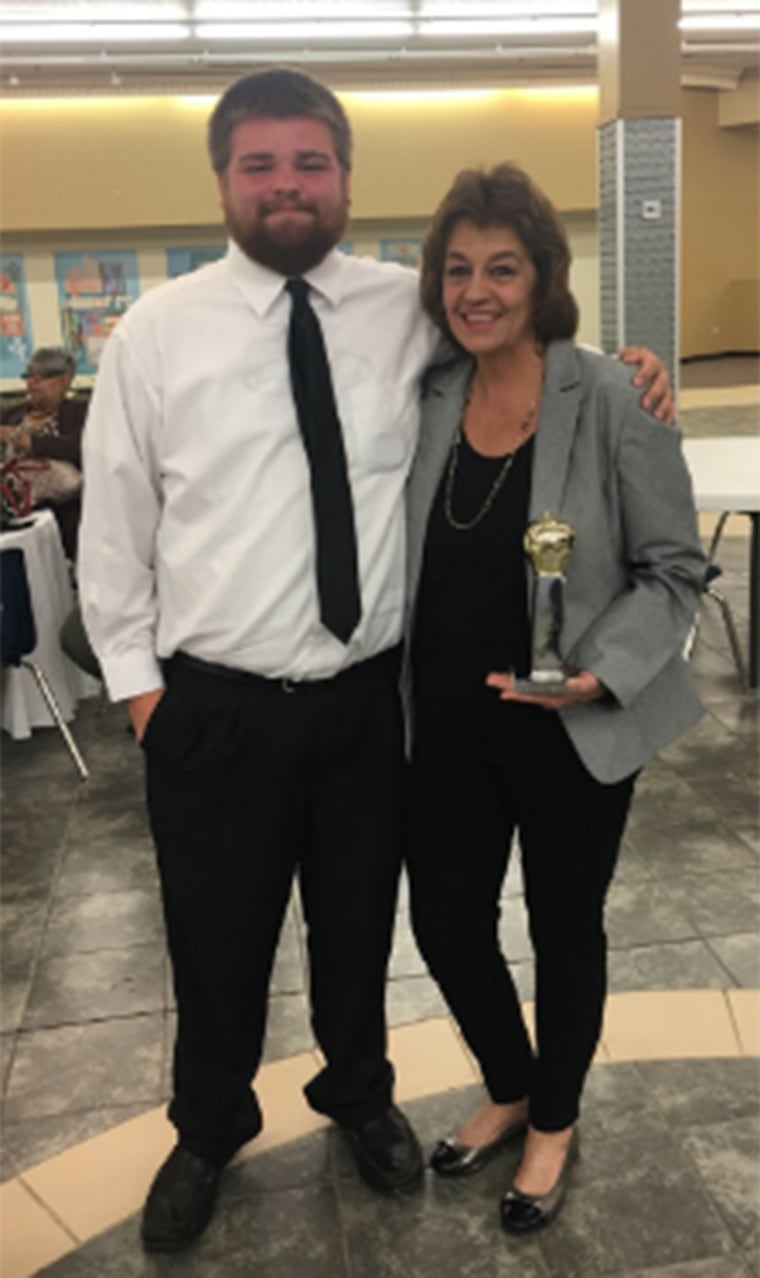 Jackie Lewis won the East Mississippi/West Alabama Golden Apple Teacher of the Year award and she could nominate a student to receive a $2,500 scholarship and laptop. She nominated Hunter Mollett and took him as her guest.