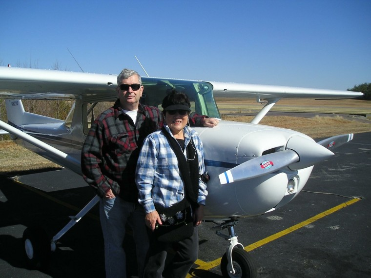 Bob and Setsuko Harmon next to one of the Cessna plans Setsuko used to fly.