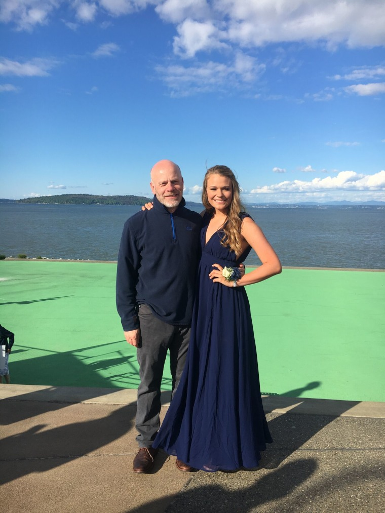 Meg Sullivan with her dad before her senior prom this spring.