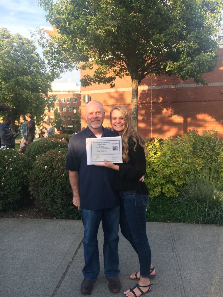 Meg Sullivan with her dad, Tom, at a scholarship awards ceremony last month.