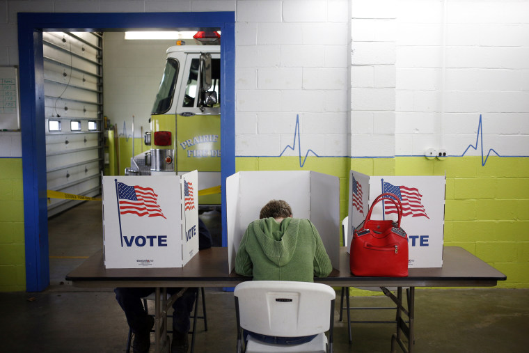 Image: Voters cast ballots inside the Prairie Township Fire Station polling location
