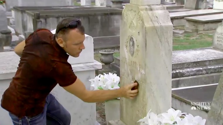 """Image: Andrew Lumish, Tampa's \""""good cemeterian\"""" cleans the headstones of fallen soldiers."""