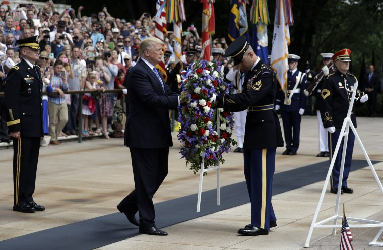 Image: President Donald Trump lays a wreath at The Tomb of the Unknown Solider at Arlington National Cemetery, Monday, May 29, 2017, in Arlington, Virginia.