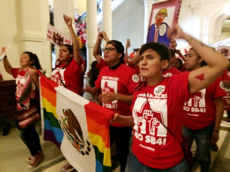 Image: Demonstrators march in the Texas Capitol on May 29, 2017, protesting the state's newly passed anti-sanctuary cities bill in Austin, Texas.