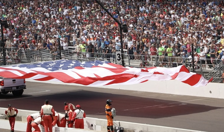 The American flag being driven for a lap around the track at the Indy500 on Sunday May 28th, 2017.