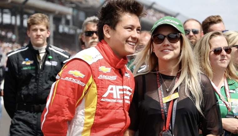 Sebastian Saavedra stands next to his wife, Jane Saavedra before the race at the  Indy500 on Sunday May 28th, 2017.