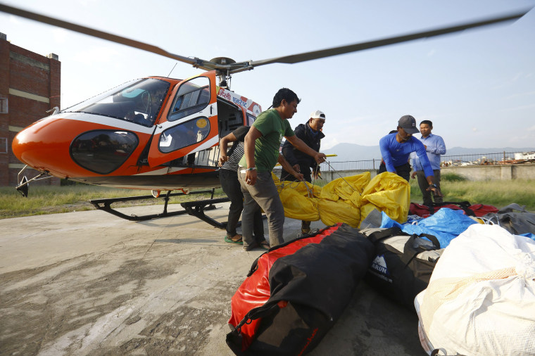 Image: Officials carry the bodies of Indian climbers recovered from Mount Everest