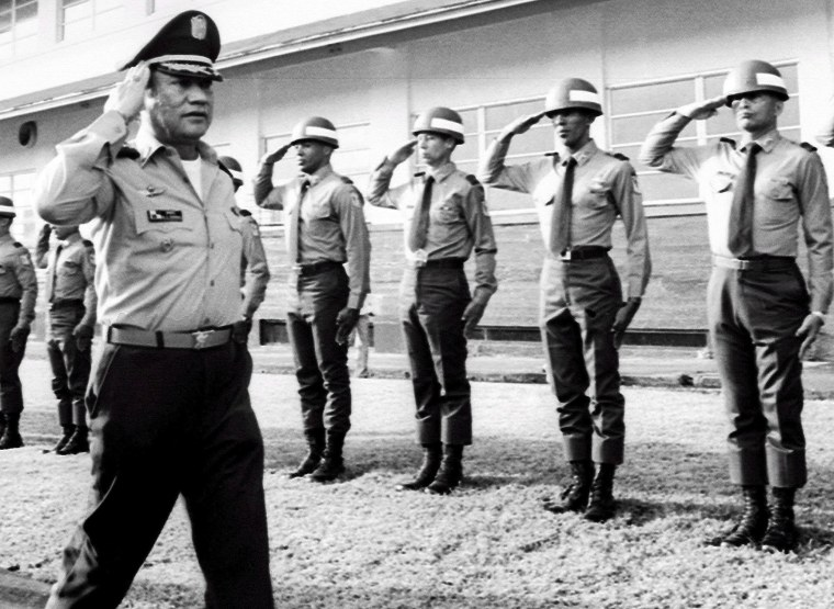 Image: Manuel Antonio Noriega salutes troops at an undisclosed location in Panama in  1985