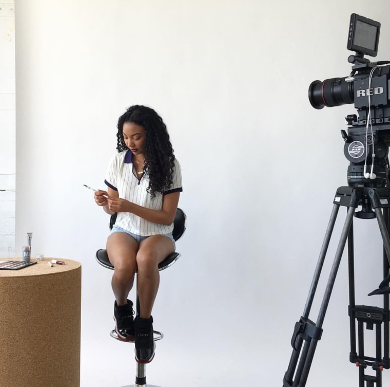 Asia Jackson shooting a video for her YouTube channel.
