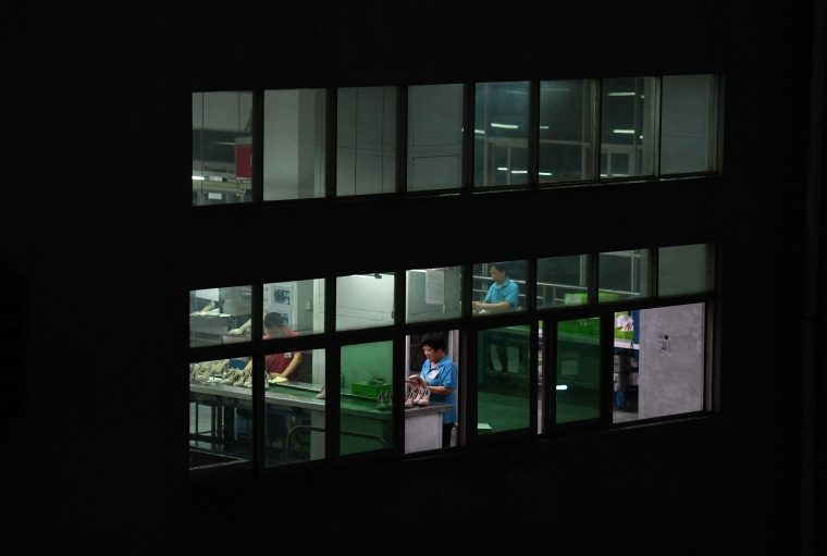 Image: Night-shift workers at the Huajian shoe factory