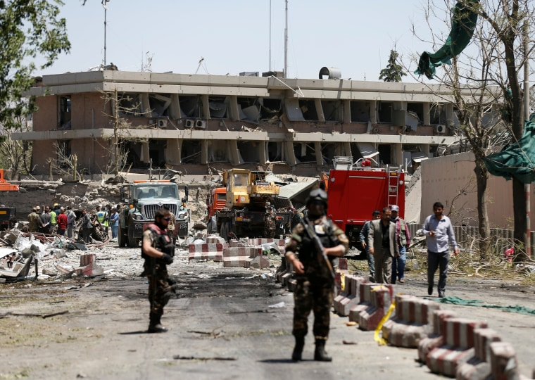 Image: Afghan officials inspect outside the German embassy after a blast in Kabul, Afghanistan