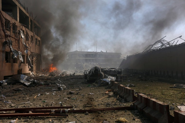 Image: Damaged cars are seen after a blast in Kabul, Afghanistan