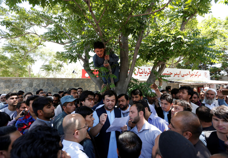 Image: Relatives of victims listen to hospital officials after a blast in Kabul, Afghanistan