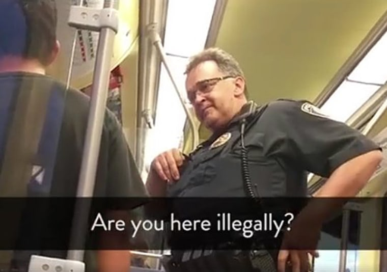 A transit police officer asks Ariel Vences-Lopez about his immigration status in Minneapolis.