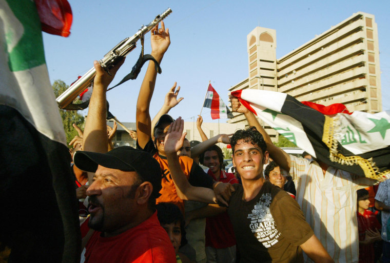 Image: Iraqi supporters celebrate the victory of their country's football team against Saudi Arabia for the final of the Asian Football Cup 2007