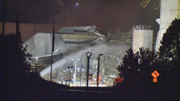 Image: Emergency crews work at the scene of a blast and large fire at the Didion Milling plant in Cambria, Wisconsin