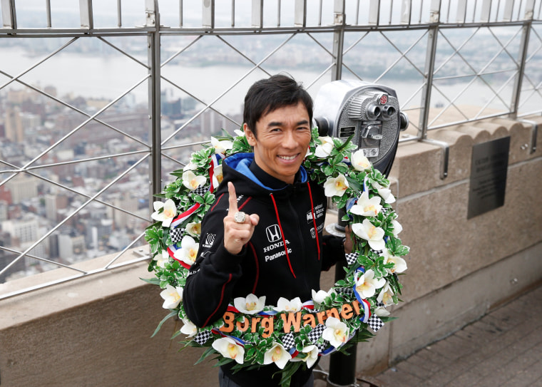 Image: Indy 500 winner Sato poses during visit to Empire State Building in New York