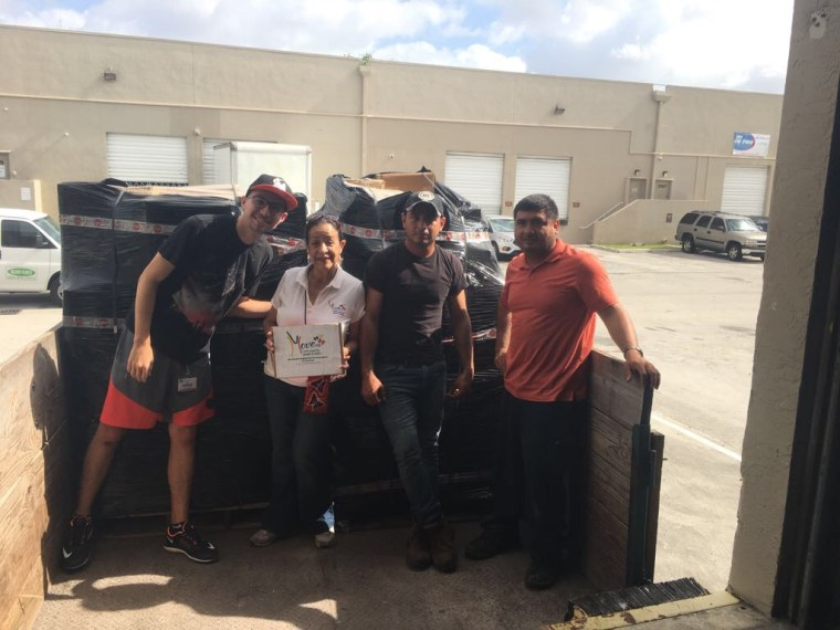 """Hilda Marina Alcala (center) with volunteers from Move Org, a group that has recently stopped sending supplies to Venezuela after the government banned what it calls """"war materials."""""""