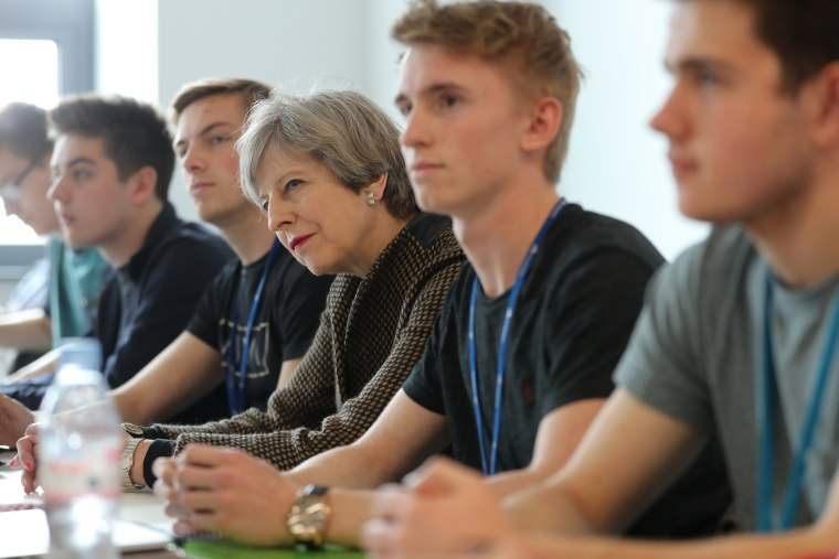 Image: Prime Minister Theresa May during a visit to the International Aviation Academy in Norwich, England
