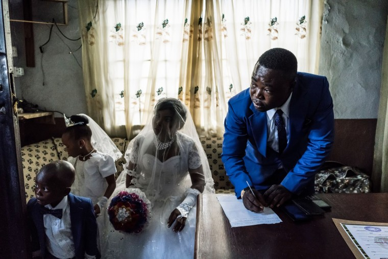Image: A bride and groom sign wedding documents in Aba, Nigeria