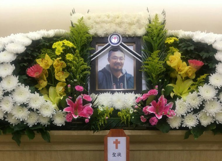 A portrait of Phillip Clay displayed at his funeral in South Korea.
