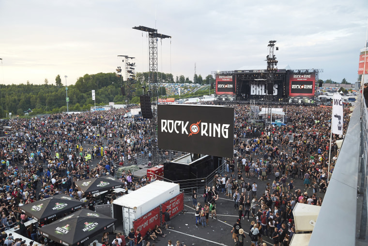Image: Visitors leave the music festival Rock am Ring