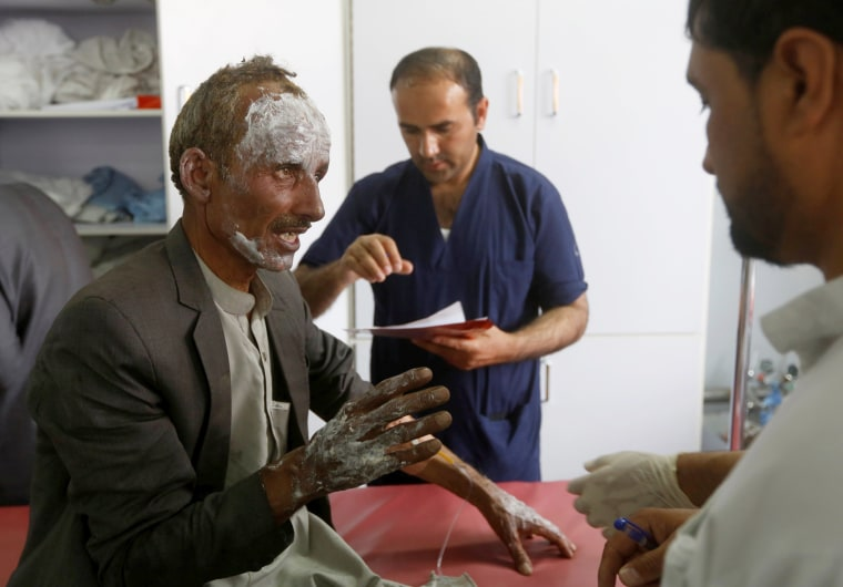Image: An injured man receives treatment at a hospital after the blasts.