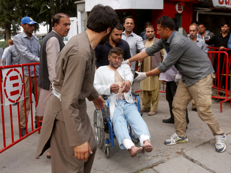 Image: An injured man leaves the hospital after receiving treatment.