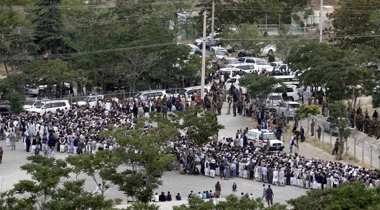 Image: People gathered for funeral services, before any explosions erupt.