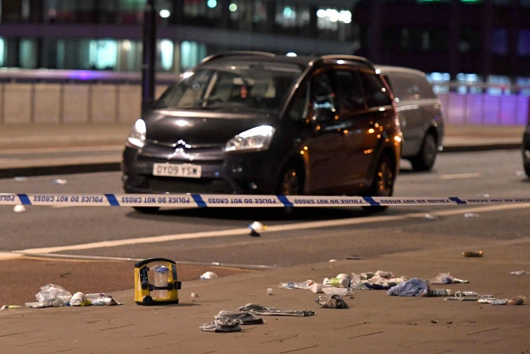 Image: Debris and abandoned cars are scattered across London Bridge on Saturday night
