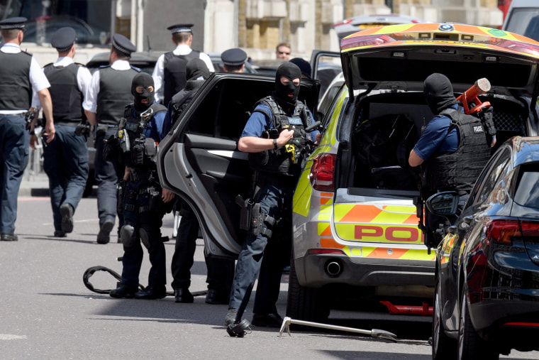 Image: Armed police officers return to their vehicles as Prime Minister Theresa May calls a meeting of the emergency response committee, Cobra.