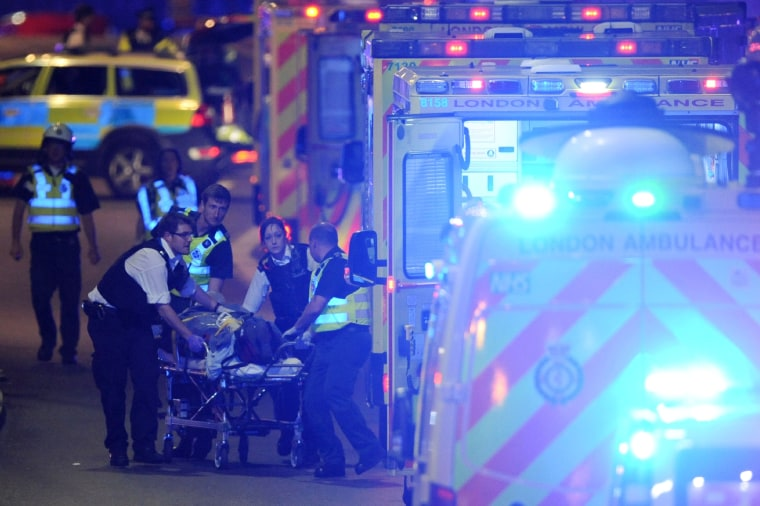Image: Police officers and members of the emergency services attend to injured people.