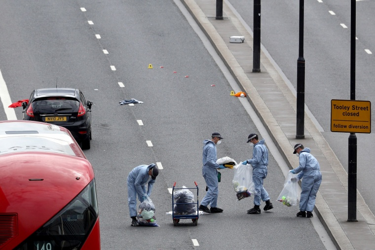 Image: Forensic officers work at on the London Bridge following last night's attack.