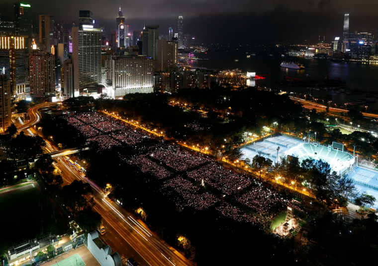 Image: Thousands of people take part in a candlelight vigil to mark the 28th anniversary of June 4th crackdown, in Hong Kong